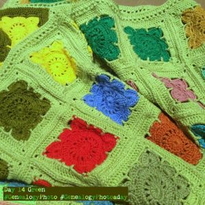 Green edged crocheted granny squares